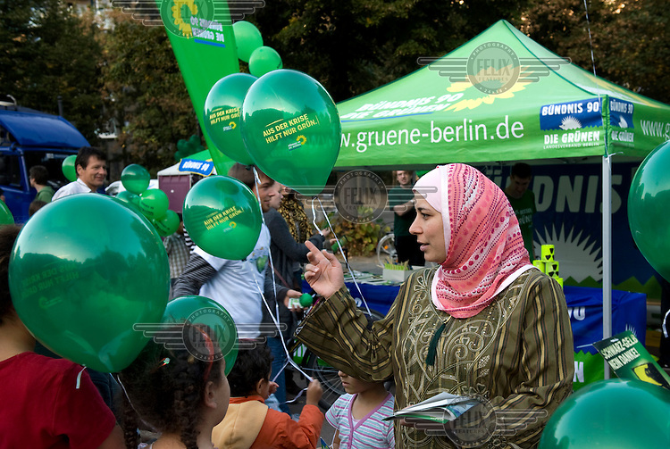 Muslim woman with headscarf campaigning at a rally for the German Green Party, in the run-up to the general election.
