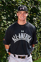 First Baseman Ryan Johnson (32) of College Station High School in College Station, Texas poses for a photo before the Under Armour All-American Game on August 24, 2013 at Wrigley Field in Chicago, Illinois.  (Mike Janes/Four Seam Images)
