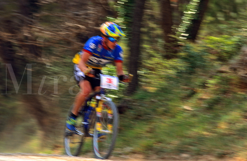 Cyclist on track during mountain bike race.