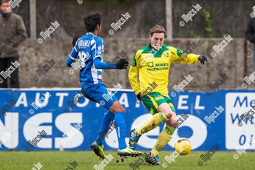 2013-12-15 / Voetbal / Seizoen 2013-2014 / Witgoor-Tienen / Amardeep Singh (l. Tienen) in duel met Olivier Schops (r. Witgoor)<br /> <br /> Foto: Mpics.be