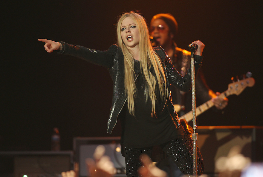 Singer Avril Lavigne performs on stage at the Paramount on Wednesday, Dec 11, 2013. Soul Brother
