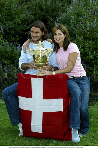 ROGER FEDERER of Switzerland and his girlfriend Miroslava Vavrinec with the trophy after he won the Mens Singles Title, 2003 Wimbledon Tennis Championships, 030706 Photo: Glyn Kirk/actionplus...2003 player players man.Grand Slam Grandslam.cup winner win