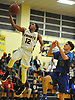 Danny Ashley #12 of Uniondale, left, drives to the net for a lay up during the second quarter of a non-league varsity boys basketball game against Copiague in the Richard Brown Nassau-Suffolk Challenge at Uniondale High School on Saturday, Jan. 13, 2018.