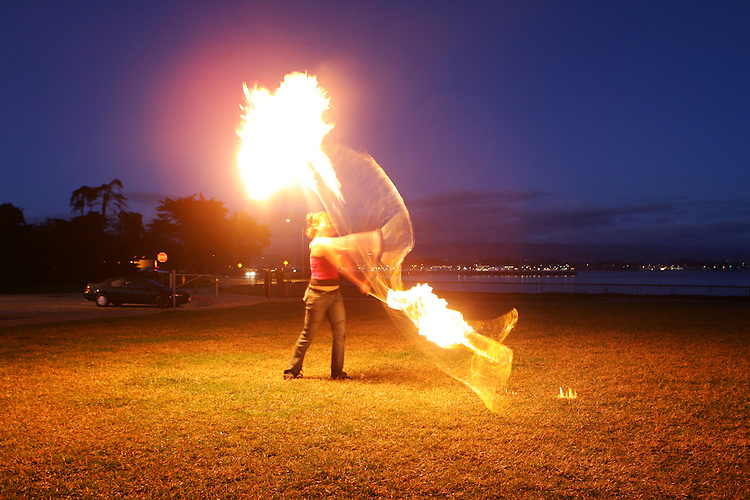 January 27, 2008; Santa Cruz, CA, USA; A fire artist performs at night at Lighthouse Field State Beach in Santa Cruz, CA. Photo by: Phillip Carter