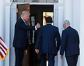 United States President-elect Donald Trump and Vice President-elect Mike Pence greet Mitt Romney at the clubhouse at Trump International Golf Club, November 19, 2016 in Bedminster Township, New Jersey. <br /> Credit: Aude Guerrucci / Pool via CNP