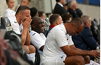 (L-R) Lee Trundle, Adrian Forbes and Roberto Martinez share a joke in the dug out during the Alan Tate Testimonial Match, Swansea City Legends v Manchester United Legends at the Liberty Stadium, Swansea, Wales, UK