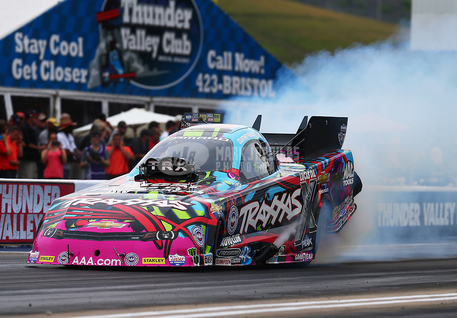 Jun 19, 2015; Bristol, TN, USA; NHRA funny car driver Courtney Force during qualifying for the Thunder Valley Nationals at Bristol Dragway. Mandatory Credit: Mark J. Rebilas-