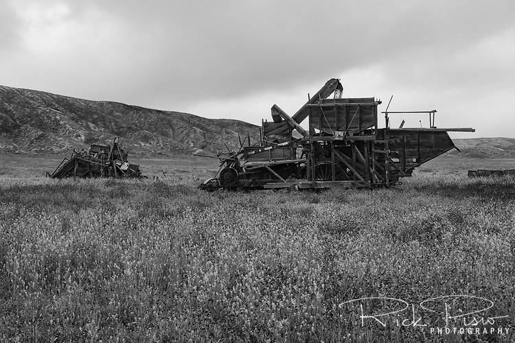 A pair of combine harvesters provide evidence of the Carrizo Plain's agricutural past as they slowly decay.