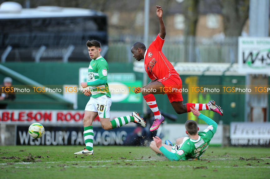 Febian Brandy of Walsall is tackeled by Kevin Dawson of Yeovil Town - Yeovil Town vs Walsall - NPower League One Football at Huish Park, Yeovil, Somerset - 29/03/13 - MANDATORY CREDIT: Denis Murphy/TGSPHOTO - Self billing applies where appropriate - 0845 094 6026 - contact@tgsphoto.co.uk - NO UNPAID USE.