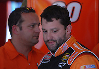 Apr 27, 2007; Talladega, AL, USA; Nascar Nextel Cup Series driver Tony Stewart (20) with crew chief Greg Zipadelli during practice for the Aarons 499 at Talladega Superspeedway. Mandatory Credit: Mark J. Rebilas