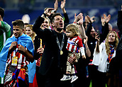 16th May 2018, Stade de Lyon, Lyon, France; Europa League football final, Marseille versus Atletico Madrid; Atletico Madrid manager Diego Simeone singing with the Atletico Madrid fans with his his daughter wearing a winners medal