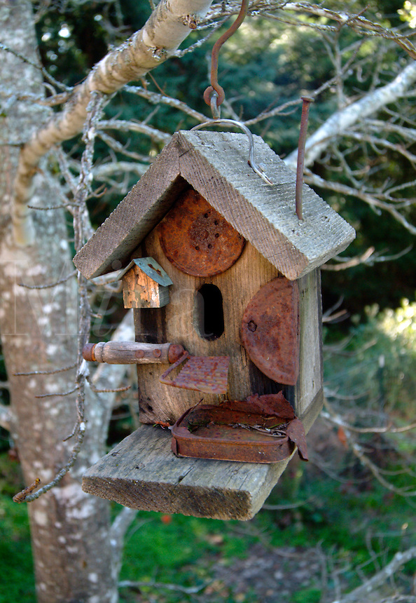 A rustic birdhouse is made with old tools and tin cans in Occidental California