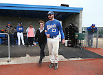 Wildcats' Corey Pool takes the field with his family during Sophomore Day ceremonies at Western Nevada College in Carson City, Nev., on Saturday, April 25, 2015. <br /> Photo by Cathleen Allison