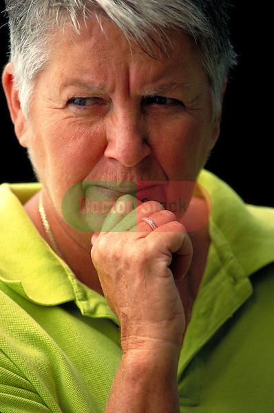 portrait of frowning elder woman