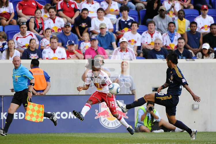 Dane Richards (19) of the New York Red Bulls crosses the ball. The Los Angeles Galaxy defeated the New York Red Bulls 1-0 during a Major League Soccer (MLS) match at Red Bull Arena in Harrison, NJ, on August 14, 2010.