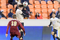 Houston, TX - Friday December 9, 2016: Luis Argudo (2) of the Wake Forest Demon Deacons heads the ball away from his goal against the Denver Pioneers at the NCAA Men's Soccer Semifinals at BBVA Compass Stadium in Houston Texas.