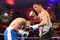 Jay Harris (black shorts) defeats Gyula Dodu during a Charity Dinner Boxing Show at the Hilton Hotel on 13th November 2017