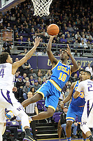 JAN 1, 2016:  UCLA's #10 Isaac Hamilton drives to the basket against Washington.  Washington defeated #25 ranked UCLA 96-93 in double overtime at Alaska Airlines Arena in Seattle, WA.