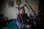 In Home Supportive Services (IHSS) client, quadriplegic Francisco Godoy is lifted into bed in his Sacramento, CA home January 22, 2010. Francisco needs around-the-clock care from Teresita, his ex-wife who also lives with him. The state pays Teresita for 283 hours per month, at $10.40/hour. Gov. Schwarzenegger has proposed cutting or eliminating the IHSS program which provides care for 450,000 Californians and jobs for 375,000 caregivers. If the program was eliminated, most would need to be institutionalized, likely at far greater taxpayer expense. CREDIT: Max Whittaker for The Wall Street Journal.CABUDGET