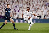 23rd November 2019; Estadio Santiago Bernabeu, Madrid, Spain; La Liga Football, Real Madrid versus Real Sociedad; Rodrygo (Real Madrid)  clears the ball from Llorente of Sociedad