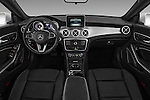 Stock photo of straight dashboard view of 2016 Mercedes Benz CLA Class CLA250 4 Door Sedan Dashboard
