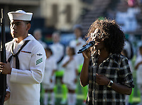 Seattle, WA - Saturday July 23, 2016: National anthem singer prior to a regular season National Women's Soccer League (NWSL) match between the Seattle Reign FC and the Orlando Pride at Memorial Stadium.
