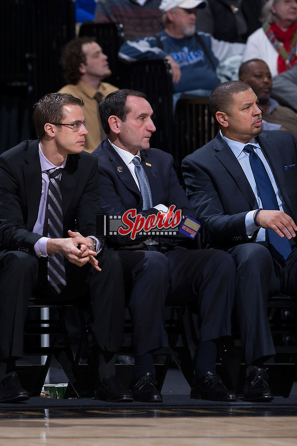(L-R) Duke Blue Devils coaches Jon Scheyer, Mike Krzyzewski, and Jeff Capel during first half action against the Wake Forest Demon Deacons at the LJVM Coliseum on January 7, 2015 in Winston-Salem, North Carolina.  The Blue Devils defeated the Demon Deacons 73-65.  (Brian Westerholt/Sports On Film)