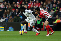 Pictured L-R: Bafetimbi Gomis against Maya Yoshida of Southampton Sunday 01 February 2015<br />