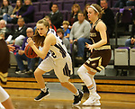 SIOUX FALLS, SD - NOVEMBER 25: Lauren Sanders #32 from the University of Sioux Falls drives past Meleah Reinhart #1 from Southwest Minnesota State University during their game Saturday evening at the Stewart Center in Sioux Falls. (Photo by Dave Eggen/Inertia)