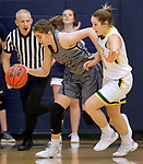 RAPID CITY, SD: DECEMBER 1:  Anna Haugen #22 of South Dakota Mines tries to dribble away from Black Hills State defender Remi Wientjes #10 during their Rocky Mountain Athletic Conference women's basketball game Saturday evening at the King Center Rapid City, S.D.  (Photo by Richard Carlson/dakotapress.org)