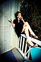 Break Time in that Little Black Dress.<br /> Thrift Store fashion.  Photography by Liisa Roberts.