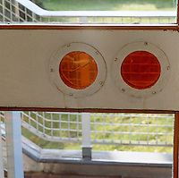 The pair of porthole windows in the entrace hall are glassed in vibrant orange and were once used in children's games