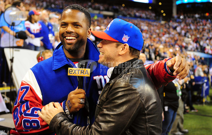Feb 5, 2012; Indianapolis, IN, USA; Movie actor Donnie Wahlberg (right) is interviewed before Super Bowl XLVI between the New England Patriots and the New York Giants at Lucas Oil Stadium.  Mandatory Credit: Mark J. Rebilas-