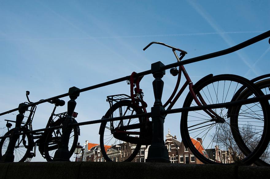 Nederland, Amsterdam, 18 febr 2013<br /> Fietsen op een brug gestald. <br /> Foto(c): Michiel Wijnbergh