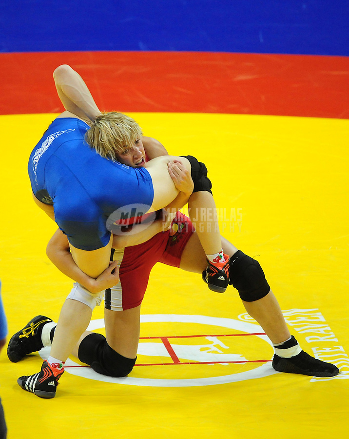 Jun 13, 2008; Las Vegas, NV, USA; Marcie Van Dusen (red) battles Sally Roberts during the final in the womans 55kg class at the 2008 US Olympic Team Trials at the Thomas and Mack Center. Van Dusen won the match and qualified for the Olympics. Mandatory Credit: Mark J. Rebilas-