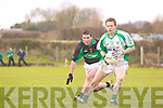 Paul Daly of Na Gaeil breaks away from Eoin Cahill of Granagh/Ballingarry in the Muster Junior B Football Final last Sunday afternoon in Knockaderry.