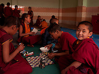 Buddhist student monks playing chess in Sikkim in the Himalayan belt