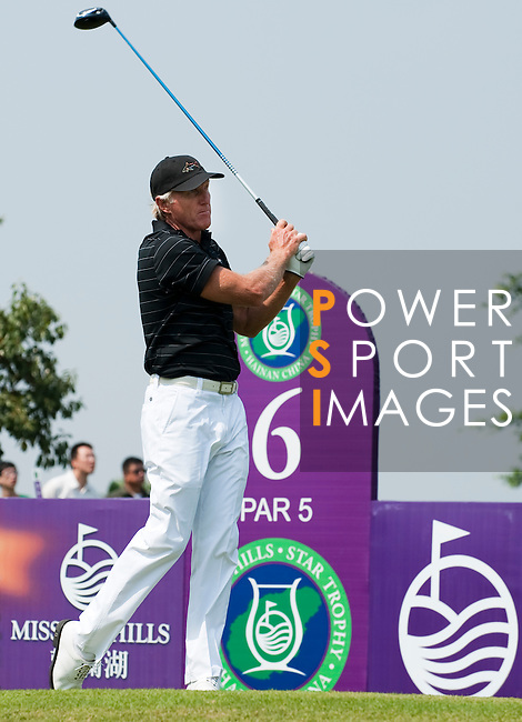 HAIKOU, CHINA - OCTOBER 30:  Golf legend Greg Norman of Australia tees off on the 6th hole during day four of the Mission Hills Start Trophy tournament at Mission Hills Resort on October 30, 2010 in Haikou, China. The Mission Hills Star Trophy is Asia's leading leisure liflestyle event and features Hollywood celebrities and international golf stars.  Photo by Victor Fraile / The Power of Sport Images
