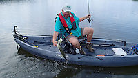 NWA Democrat-Gazette/FLIP PUTTHOFF <br /> Mike McBride catches a Lake Sequoyay largemouth bass June 24, 2016 with a spinner bait. Spinner baits and buzz baits are good summertime lures at lake, located near Arkansas 16 in southeast Fayetteville.