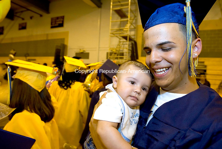 WATERBURY, CT --JUNE 16, 2008-061608JS12-Kennedy High School graduate Dennis Demirel holds his four-month old son Jayden Demirel following Monday's commencement exercises at Kennedy High School in Waterbury. <br /> Jim Shannon/Republican-American