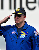 Alan Poindexter, Commander of the STS-131 mission, salutes as the National Anthem is sung during the ceremony where the Space Shuttle Discovery will be signed over to replace the Space Shuttle Enterprise at the Smithsonian Institution's Steven F. Udvar-Hazy Center   in Chantilly, Virginia awaiting the arrival of the  on Thursday, April 19, 2012.  Enterprise will be on permanent display at the Intrepid Museum in New York, New York..Credit: Ron Sachs / CNP..(RESTRICTION: NO New York or New Jersey Newspapers or newspapers within a 75 mile radius of New York City)