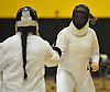 Lizzie Colonna of Commack, right, duels against Delmy Santos of Brentwood in epee during a girls fencing match at Commack High School on Friday, Dec. 2, 2016. Colonna won the bout 5-3.