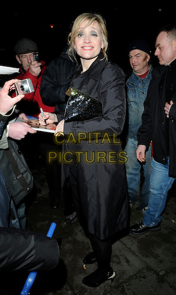 ANNE-MARIE DUFF .Outside  - The 30th London Critics' Circle Film Awards, Landmark Hotel, Landmark Hotel, London, England, UK, 18th February 2010..full length black coat sequined sequin clutch bag shoes tights smiling Anne Marie signing autographs fans .CAP/CAN.©Can Nguyen/Capital Pictures