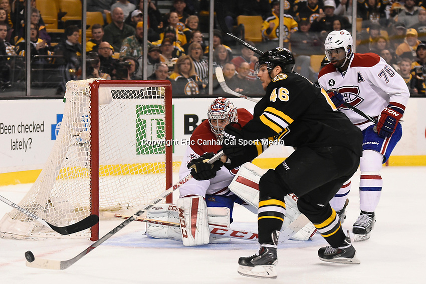 February 8, 2015 - Boston, Massachusetts, U.S. - Boston Bruins center David Krejci (46) reaches for the puck in front of Montreal Canadiens goalie Carey Price (31) during the NHL game between the Montreal Canadiens and the Boston Bruins held at TD Garden in Boston Massachusetts. The Canadiens defeated the Bruins 3-1 in regulation time. Eric Canha/CSM