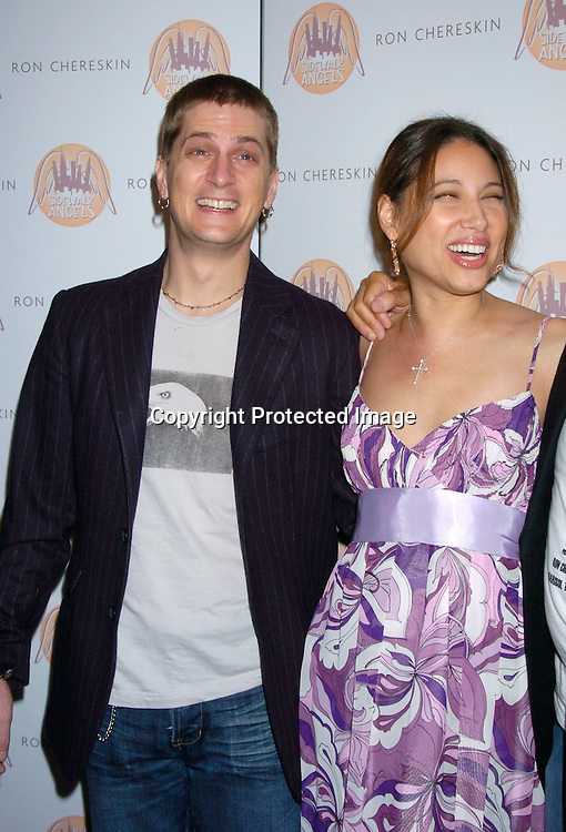 Rob and Marisol Thomas ..at the benefit for Sidewalk Angels Foundation on August 3, 2004 at The China Club. ..Photo by Robin Platzer, Twin Images..