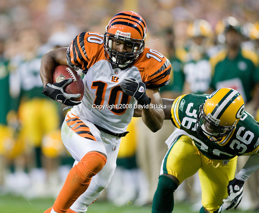 Running back Marcus Maxwell #10 of the Cincinnati Bengals carries the ball against the Green Bay Packers at Lambeau Field on August 11, 2008 in Green Bay, Wisconsin. The Bengals beat the Packers 20-17. (AP Photo/David Stluka)