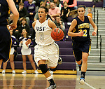 SIOUX FALLS, SD - JANUARY 2:  Taylor Varsho #3 from the University of Sioux Falls pushes the ball past Nicole Kerkhoff #32 from Augustana in the first half of their game Friday night at the Stewart Center. (Photo by Dave Eggen/Inertia)