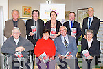 "BOOK: Looking oiver the new book by Pa?draig O Concubhair (arthur) of the ""The Fenians were Dreadful Men"" at Kerry County Clibrary on Saturday. Front l-r: Mark Codd, Kathlkeen Browne, Padraifg O'Conchubair aqnd Mary Phelan. Back l-r: Raymond Roche, Gabriel Fitzmaurice, Declan Downey(who launched the book) and Tom O'Connor (Kerry County Librian)...."