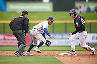 Burlington Bees shortstop Juan Moreno (2) retrieves the ball after Kyle Tucker (19) slid into second with umpire Derek Thomas watching the play during a game against the Quad Cities River Bandits on May 9, 2016 at Modern Woodmen Park in Davenport, Iowa.  Quad Cities defeated Burlington 12-4.  (Mike Janes/Four Seam Images)