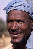 Kamkamtuti, Niger. Jgoro Ahmadou, A Fulani Village Chief, with Typical Facial Scarification.